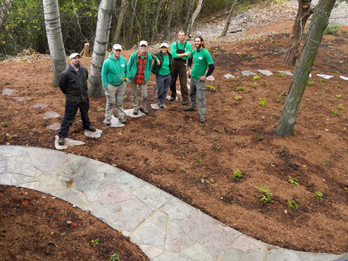 Good Oak staff standing next to a completed hardscaping project